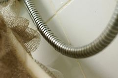 Flexible water tube for shower in bath room Stock Photography