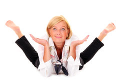 Flexible woman. A picture of a mature flexible woman lying over white background Royalty Free Stock Images
