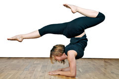 Flexible woman. Young woman demonstrating her flexibility Stock Photos