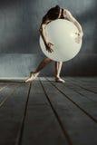 Flexible woman dancing using the white balloon Royalty Free Stock Photos