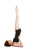Flexible woman doing shoulder stand Stock Photos