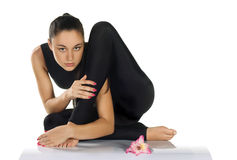 Flexible woman gymnast royalty free stock images