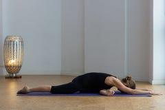 Free Flexible Woman Lying Down On Pigeon Pose At Yoga Studio Stock Photo - 206258080