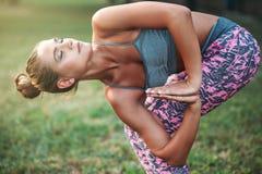 Flexible woman meditating, yoga training Royalty Free Stock Photos