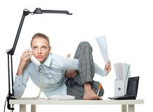 Flexible woman in office. Doing multiple jobs at the same time stock image