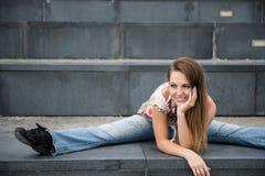 Flexible woman outdoor portrait Stock Photo