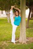 Flexible woman at a park Royalty Free Stock Image