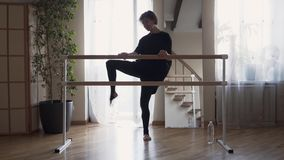 Flexible woman practicing at home. Elegant slim woman in black clothes doing exercises indoors. Happy life, keeping in. Flexible adult woman practicing at home stock video