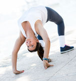 Flexible woman stretching back Royalty Free Stock Image