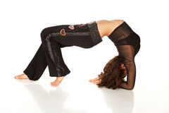 Flexible woman stretching and doing back-bend Stock Images