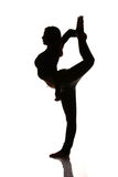 Flexible woman stretching silhouette Royalty Free Stock Photo