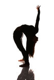 Flexible woman stretching silhouette Stock Photo