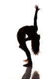 Flexible woman stretching silhouette Royalty Free Stock Photography