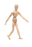 Flexible wooden doll. Is walking over white background Stock Photo