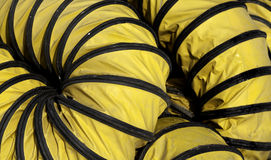 Flexible yellow hose Stock Photos