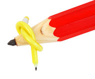 Flexible yellow pencil and big red pencil Royalty Free Stock Photography