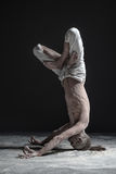 Flexible yoga man standing in yoga shirshasana headstand pose. Royalty Free Stock Images