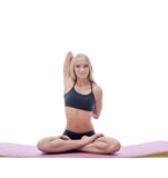 Flexible young blonde doing yoga in studio Royalty Free Stock Photos