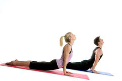 Flexible Young Couple. Young couple stretching doing yoga exercises Royalty Free Stock Photos