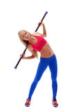 Flexible young female athlete posing with fitbar Stock Image