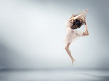 Flexible young girl in ballet figure Royalty Free Stock Photography
