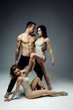Flexible young modern acrobats couple posing in studio. Royalty Free Stock Images