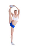Flexible young woman in shorts and top Stock Photos
