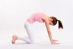 Flexible young yoga girl. Royalty Free Stock Image