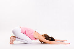 Flexible young yoga girl. Royalty Free Stock Images