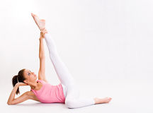 Flexible young yoga girl. Stock Photo