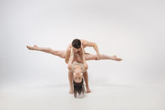 Flexile young ballet dancers dancing in the white studio stock images