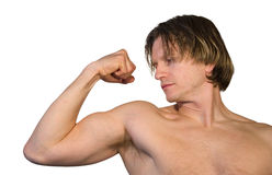 Flexing. Man flexing his muscles Royalty Free Stock Images