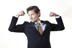 Flexing businessman Stock Photos
