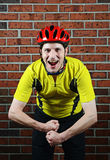 Flexing Cyclist. Image of a cyclist flexing Royalty Free Stock Photos