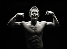 Flexing fitness man Stock Photography