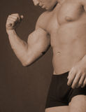 Flexing his muscle royalty free stock photos