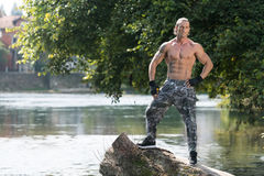 Flexing Muscles Outdoors In Nature Royalty Free Stock Image