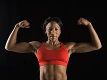 flexing muscles woman Στοκ εικόνα με δικαίωμα ελεύθερης χρήσης