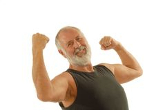 Flexing senior. Fit older man showing off the muscles he's kept throughout his life; isolated on white Stock Image