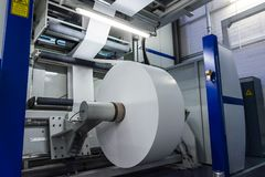 Flexography Roll Material Printed Sheets Cylinder Production Ind. Ustrial Magenta Rollers Printer Industry Commercial Heavy Flourescent Lights Machine royalty free stock photography