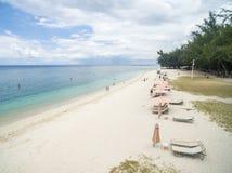 FLIC EN FLAC,毛里求斯- 2015年12月04日:风景和海滩在Flic Flac,毛里求斯 游人和印度洋 库存照片
