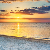 Flic en flac beach at sunset. Royalty Free Stock Images
