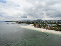FLIC EN FLAC, MAURITIUS - DECEMBER 04, 2015: Landscape and Beach in Flic an Flac, Mauritius. Cloudy Sky and Indian Ocean Royalty Free Stock Photo