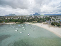 FLIC EN FLAC, MAURITIUS - DECEMBER 04, 2015: Landscape and Beach in Flic an Flac, Mauritius. Tourists, boats, yachts Indian Ocean Stock Photo
