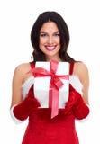 Flicka för jultomtenhjälpredajul med en gåva. Royaltyfri Fotografi
