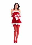 Flicka för jultomtenhjälpredajul med en gåva. Fotografering för Bildbyråer