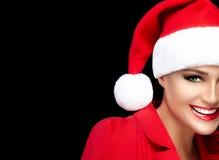 Flicka för lycklig jul i Santa Hat med ett stort leende royaltyfri fotografi