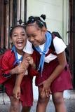 Flicka för två skola i havannacigarren, Kuba Arkivbilder