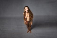 Flicka gjorda framsidor Royaltyfria Bilder