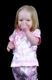 flicka henne holding little näsa Arkivbilder
